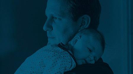 Bild på en pappa med sitt barn